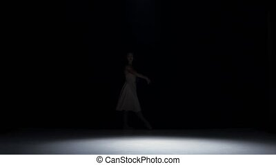 Young woman dancer dancing contemporary dance moves, jumps...