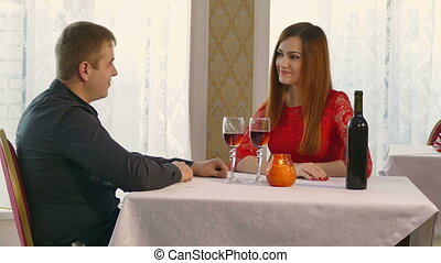 man and woman romantic evening in restaurant drinking wine,...