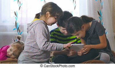 kids and tablet - play in  tablet children girls and boy