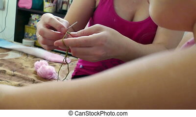 Mother and daughter knitting - lifestyle woman and teen girl...
