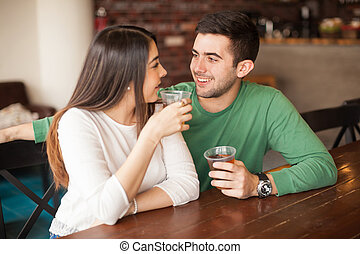 Young man flirting with a girl at the bar - Handsome young...
