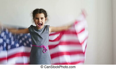 Girl and USA American Flag - girl teen shouting holding...