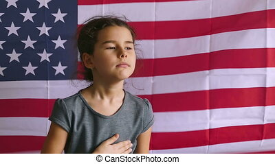 Girl and USA American Flag - teen girl holding hands on the...