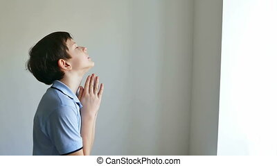 Boy praying  - boy teen  praying church belief in god