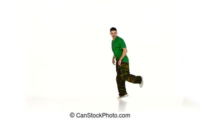 Talanted young dancer man dancing breakdance on white