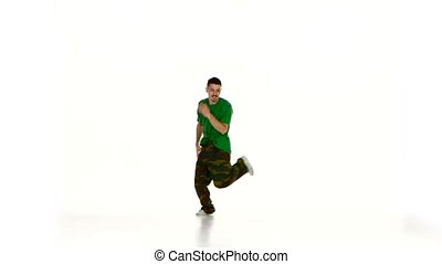 Talanted young dancer man in green shirt continue dancing...