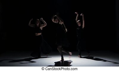 Sensual contemporary dance performance of long-haired dancer on black, shadow