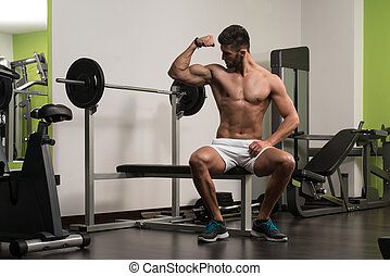 Arabic Man Showing His Well Trained Biceps - Portrait Of A...