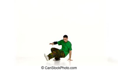 Talanted dancer man in green shirt dance breakdance on white...