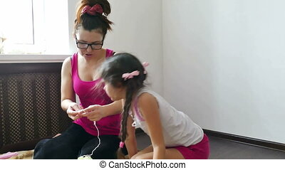 Mother and daughter knitting - woman and a teen girl knit...