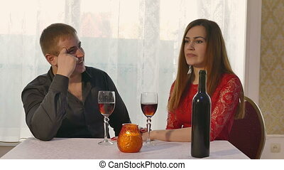 man and girl - girl yawning at a restaurant for a romantic...