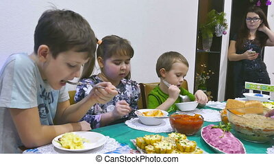 kids eat - Children eat family breakfast birthday boy and...