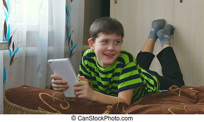 boy and tablet - boy game teenage playing on tablet internet...
