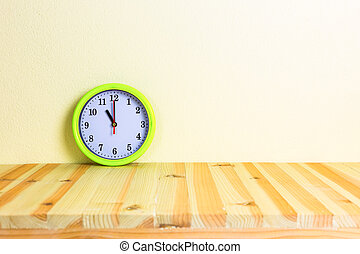 Clock wood table - Clock on wood table with concrete wall...