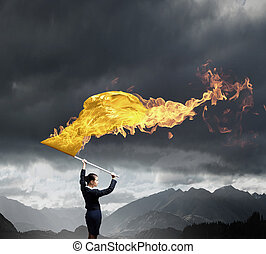 Woman waving yellow flag - Young determined businesswoman...