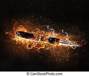 Pen burning in fire - Automatic pen in fire flames on dark...