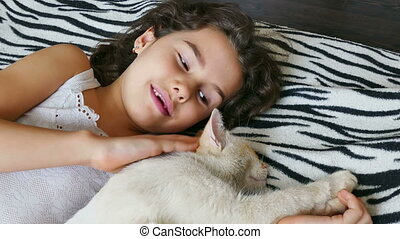 girl and cat - girl teenage stroking cat lying on bed love