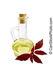 Oil with amaranth in decanter - Decanter with vegetable oil...