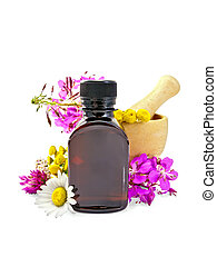 Oil with flowers and mortar - Oil in a dark bottle, fireweed...