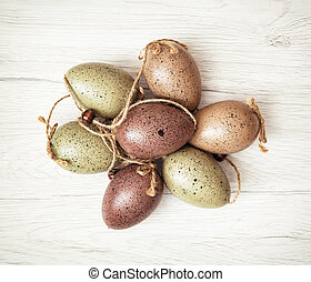 Beautiful Easter eggs on the wooden background, symbol of...