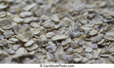 Close up of porridge oats as background or texture Diet and...