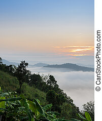 Sunrise with sea of fog above Mekong river at Phu Huai Isan...