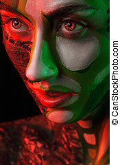 Extreme fashion make up in red and green studio light Beauty...