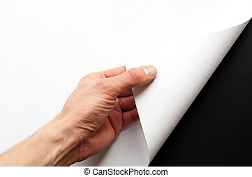 paper and hand - page or blank sheet of paper with hand and...