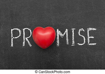 promise word handwritten on chalkboard with heart symbol...