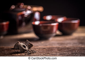Pu-erh chinese tea - Compressed pu-erh chinese tea on rustic...