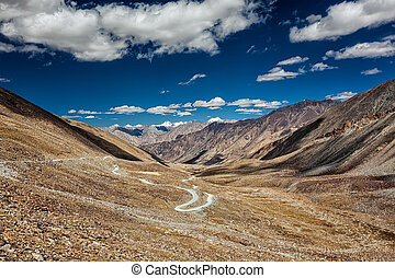 Karakoram Range and road in valley, Ladakh, India - View of...