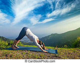Woman doing yoga oudoors in mountains - Young sporty fit...