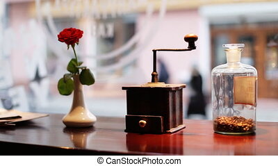 Red rose , vintage coffee grinder mill with stylish clipping...