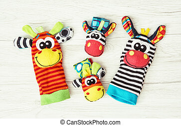 Colorful hand puppets and wrist pals, funny toys