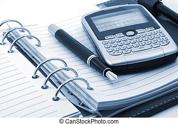 organizer and cell phone or pda showing business concept