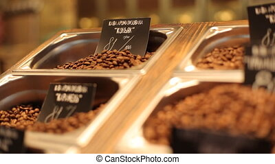 . Different kinds of coffee with a great  variety of assortment and varient prices putten on a wooden plate.