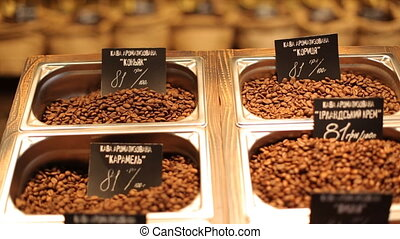 Different kinds of coffee with a great  variety of assortment and varient prices putten on a wooden plate.