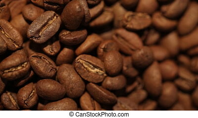 Macro dolly shot of coffee beans. Find similar clips in our...