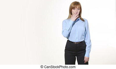 insincere gesture mouth is closed with one hand girl in...