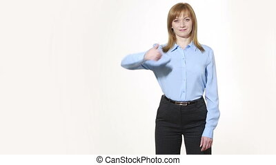 raised thumb. girl in pants and blous. Isolated on white...