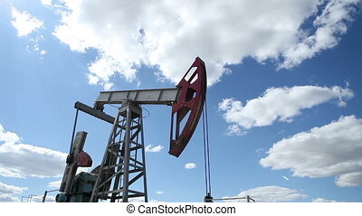 working oil pump on a background cloudy sky HD