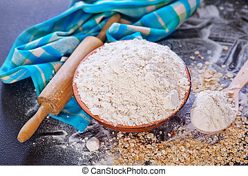 oat flour in bowl and on a table