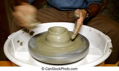 ceramist potter - Hands of a man creating pottery on wheel