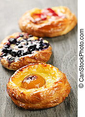 Fruit danishes - Closeup on three sweet fruit danish...