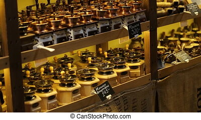 Coffee store with a big collection of different vintage coffee grinders of diffferent size and made in various stylies for sale.