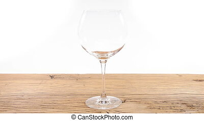 Red wine glass fill table white - Filling a red wine glass...