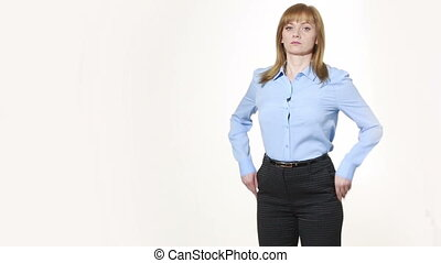 hands in pockets discomfort girl in pants and blous Isolated...
