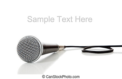 Black and silver microphone on a white background with copy...
