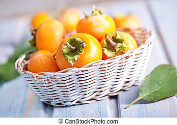 persimmon in basket and on a table