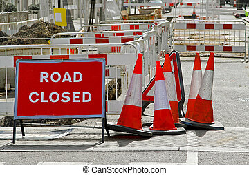 Road Works - Warning Sign and Traffic Cones on a Street...